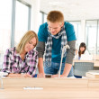 Two students at high school writing notes — Stock Photo