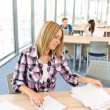 Back to school - female student in classroom — Stockfoto