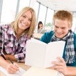 Stock Photo: Back to school - happy students with books
