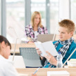 Three high school students in classroom — Stock Photo