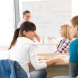 High school students with professor in classroom — Stock Photo