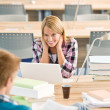 Royalty-Free Stock Photo: Two students with books and laptop in classroom