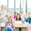 Group of students in classroom - Stock Photo