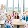 Group of students in classroom - Foto Stock