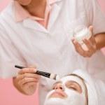 Facial mask - woman at beauty salon — Stock Photo #4692874