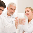Chemistry experiment - scientists in laboratory — Stock Photo