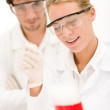 Stock Photo: Chemistry experiment - scientists in laboratory