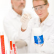 Chemistry experiment - scientists in laboratory — Stock Photo #4693143