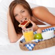 Young woman having home made breakfast — Stock Photo #4693206