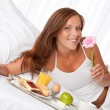 Young woman having breakfast in bed — Stock Photo #4693209