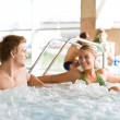 Swimming pool - couple relax in hot tub — Stock Photo
