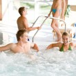 Swimming pool - young couple relax in hot tub — Stock Photo #4693311