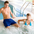 Swimming pool - couple relax in hot tub - Foto Stock