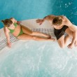Top view - young couple relax in swimming pool — Stock Photo #4693333