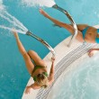 Top view - two woman relax in swimming pool — Stock Photo