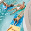 Swimming pool - young have fun — Stock Photo