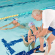 Pool coach - swimmer training competition — Stock Photo #4693366