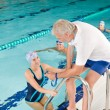 Stock Photo: Pool coach - swimmer training competition