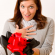 Royalty-Free Stock Photo: Surprised woman holding present shoes