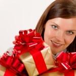 Happy woman holding Christmas presents — Stock Photo #4693486
