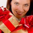 Stock Photo: Happy womholding Christmas presents