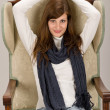 Stock Photo: Fashion model posing on antique armchair