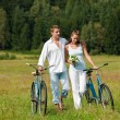 Romantic young couple walking with old bike — Stock Photo #4693590