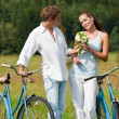 Romantic young couple walking with old bike — Stock Photo #4693593