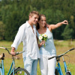 Romantic young couple walking with old bike — Stock Photo