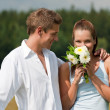 Romantic couple with flower in spring - Stock Photo