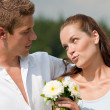 Romantic couple with flower in spring — Stock Photo #4693604