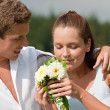 Romantic couple with flower in spring — Stock Photo #4693605