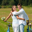 Stock Photo: Romantic young couple with old bike in spring nature