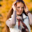 Autumn park - long red hair woman fashion — Stock Photo #4693996