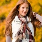 Autumn park - long red hair woman fashion — Stock Photo #4693999