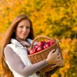 Autumn country - woman with wicker basket — Stok Fotoğraf #4694009