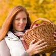 Autumn country - woman with wicker basket — Stock fotografie