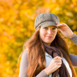 Autumn park - long red hair woman fashion — Stock Photo