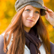 Stock Photo: Autumn park - red hair woman fashion