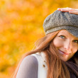Autumn park - long red hair woman fashion — Stock Photo #4694017