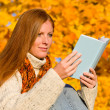 Autumn sunset country - woman read book — Stock Photo #4694032