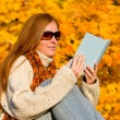 Autumn sunset country - woman read book — Stock Photo