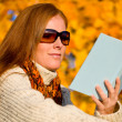 Autumn sunset country - woman read book — Stock Photo #4694036