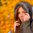 Stock Photo: Autumn sunset park - red hair woman fashion