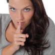 Royalty-Free Stock Photo: Beautiful woman expressing silence, finger on lips
