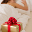 Surprise present - young woman sleeping — Stock Photo