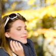 Stock Photo: Autumn park - fashion womwith sunglasses