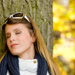 Stock Photo: Autumn park - fashion woman with sunglasses