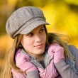Autumn park - fashion model woman wear cap — Stock Photo