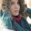 Winter fashion - woman with fur hood — Stock Photo